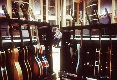 Noel Gallagher and some of his many guitars